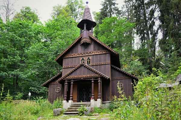 Stožecká kaple - Původní kaple Kaple Panny Marie (známá jako Stožecká kaple) – dřevěná poutní kaple, ležící v nadmořské výšce 950 metrů, byla vystavěna v roce 1791 Jakoubkem Klauserem, kovářem z Volar jako poděkování za zázračné vyléčení zraku. Je postavena nad pramenem léčivé vody, která má dle legendy zázračné léčivé účinky na zrak. Díky údajně léčivým účinkům místního pramene a zázračnému obrazu Panny Marie byla kaple hojně vyhledávána poutníky z Čech i nedalekých Bavor. Na svátek Nanebevzetí Panny Marie 15. srpna 1920 přišlo ke kapli na bohoslužby na 5600 lidí z obou stran hranic.