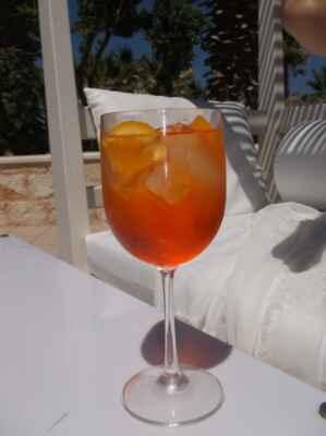 Aperol je alkoholický nápoj řadící se mezi kořeněné bittery. Má oranžovočervenou barvu s ovocnou, lehce hořkou chutí. Vyrábí se na bázi lihu z hořce, rebarbory, výtažků z pomerančů, aromatických bylin a barviv. Jeho zvláštností je velmi nízký obsah alkoholu, jen 11 %. Nejznámějším nápojem na bázi Aperolu je Aperol Spritz. Vznikl v 50. letech jako varianta benátského vinného střiku (spritz veneto), který do Benátek zřejmě přinesli Rakušané v 19. století (Benátky byly v 1. polovině 19. století součástí habsburského soustátí).